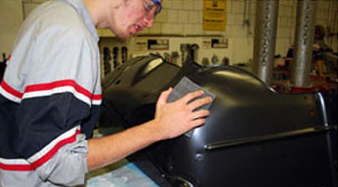 Auto Collision - Student Fixing Bumper